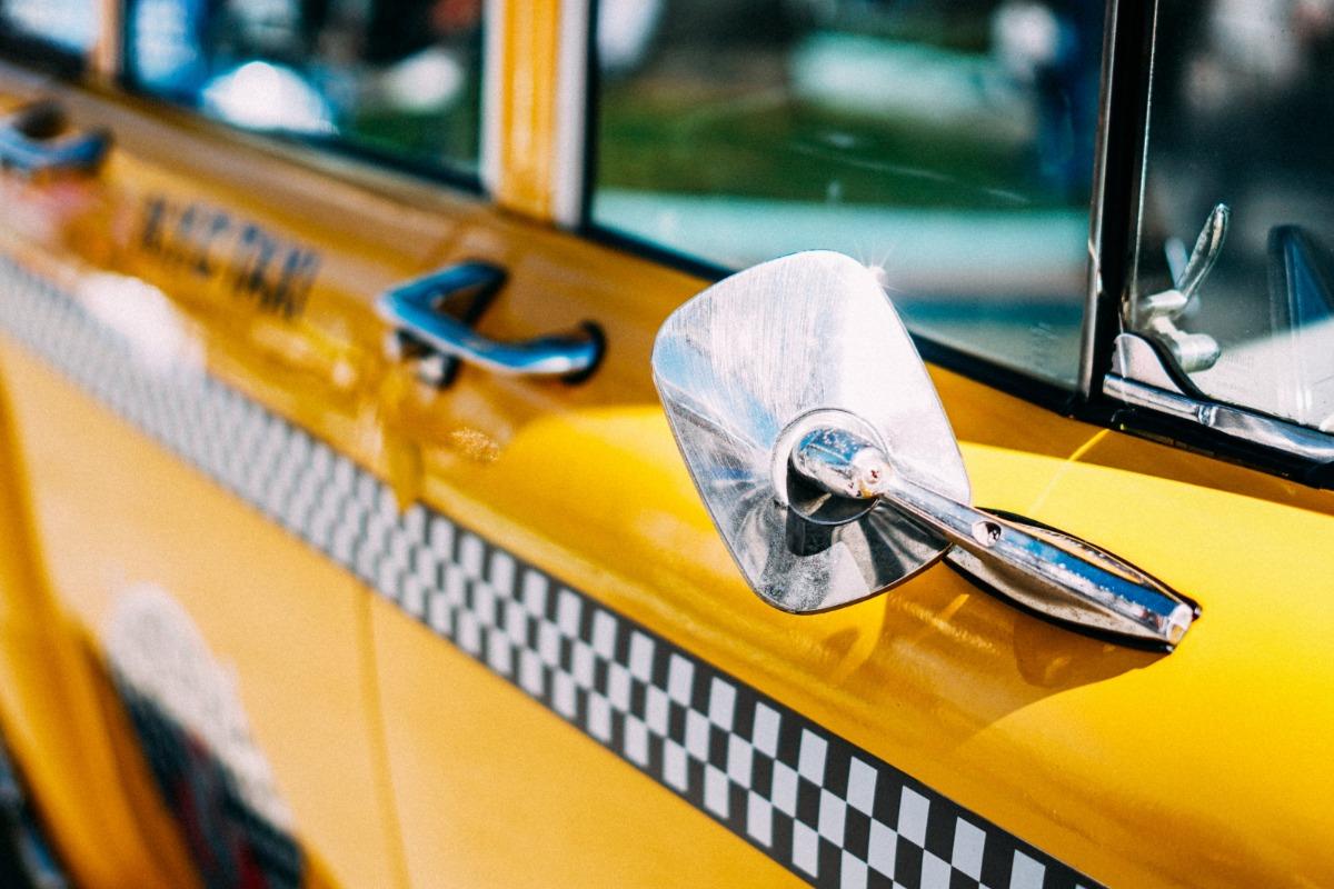 Closeup of a yellow taxi.