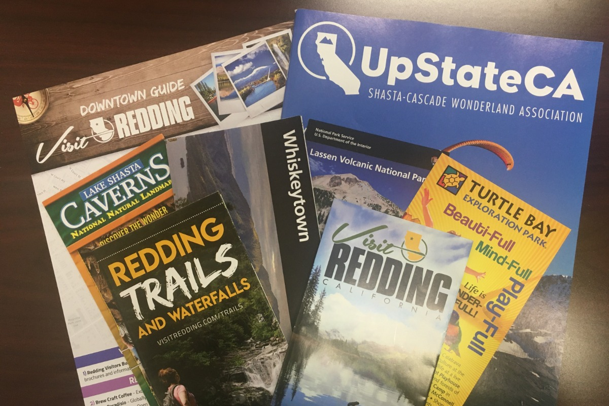 A stack of Redding brochures.