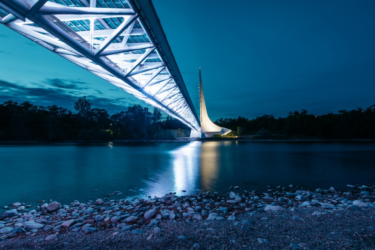 The Sundial Bridge lit up at night.