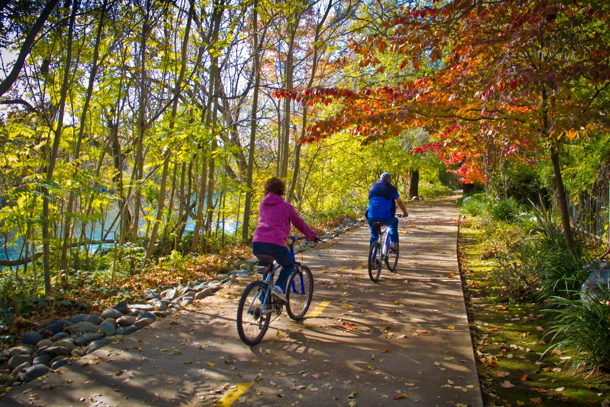 Two people biking on the Sacramento River National Recreation Trail in the fall.