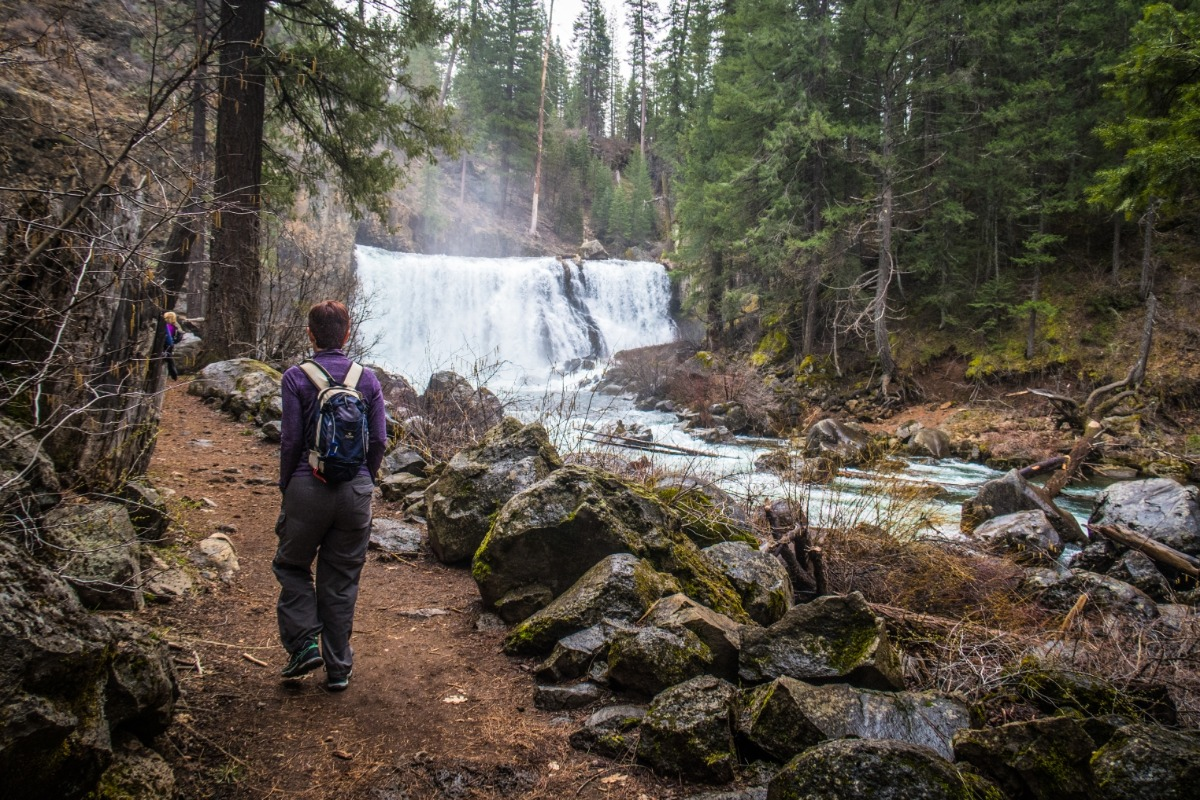 A women hiking by Middle McCloud Falls.