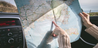A person pointing at a map.